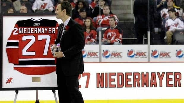 Scott Niedermayer shown in this December 2011 file phoito during his jersey retirement ceremony  in Newark, N.J, was inducted into canada's Sports Hall of Fame on Thursday.