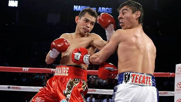 Nonito Donaire, left, hits Jorge Arce during their O junior featherweight title boxing match at Toyota Center in Houston.