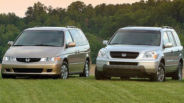 A 2003 model year Honda Odyssey and Pilot are shown, two of the makes of vehicles included in Honda's recall.