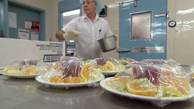 Capital Health workers prepare food.