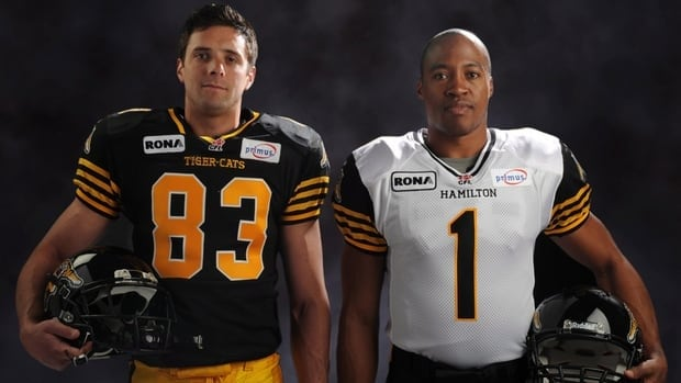 Quarterback Henry Burris, right, and receiver Andy Fantuz model the team's new jerseys.