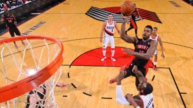 Amir Johnson (15) of the Raptors soars to the basket prior to being ejected in Monday's 92-74 road loss to the Trail Blazers.