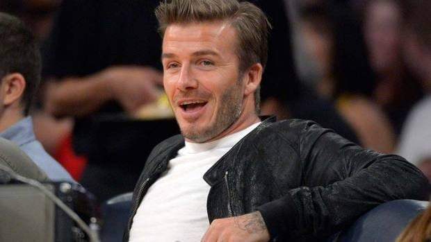 David Beckham, here in early December watching a Lakers game at Los Angeles, says he's not in a hurry to make a decision on his future back in Britain.