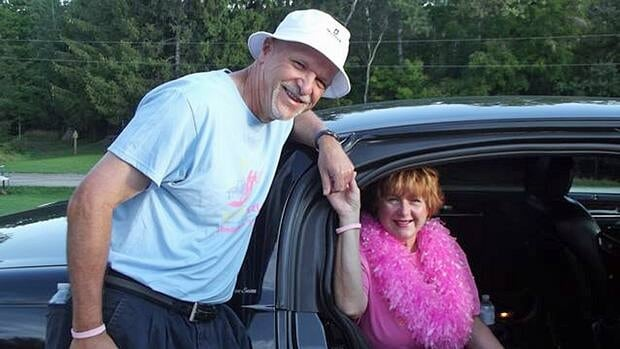 Breast cancer survivor Margaret Carter is escorted by her husband Maurice 'Mo' Carter from a limousine ride to the run last year.