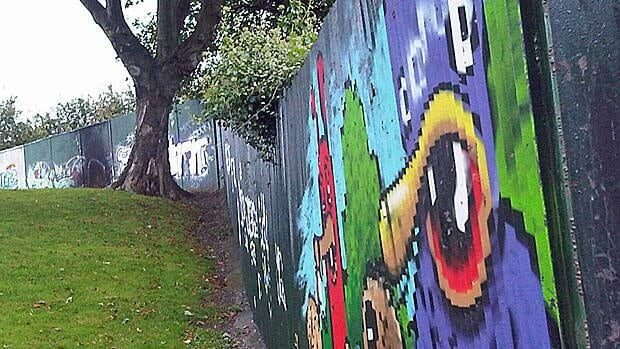 The 'peace wall' separating Protestant and Catholic neighbourhoods in the Alexandra Park area of Belfast. For part of this past year, a gate has been opened every day until 3 p.m., as an experiment.