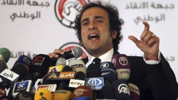 Liberal politician and member of Egypt's opposition coalition Amr Hamzawy speaks during a news conference in Cairo on Dec. 23, 2012.