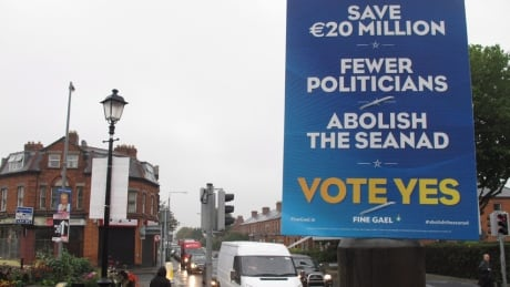 An Irish government campaign poster urges passing motorists and pedestrians to support the abolition of the country's Senate in Dublin, Ireland. (Shawn Pogatchnik/Associated Press)