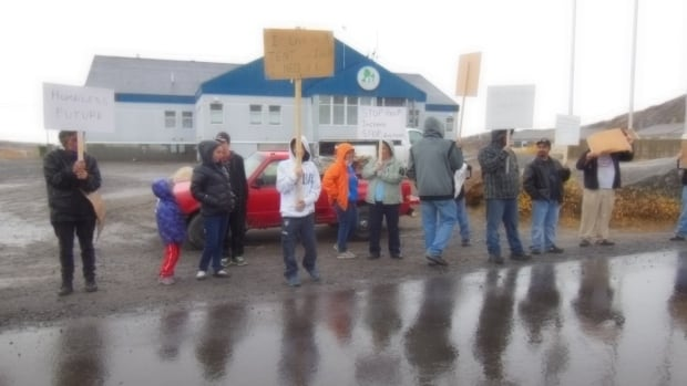 People in kuujjuaq, Que., protest evictions and high rents outside the Kativik Municipal Housing Bureau on Thursday.