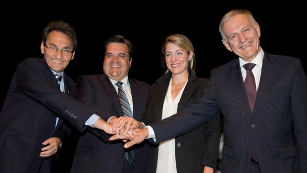 Marcel Côté, right, poses with his fellow candidates for mayor (from left) Richard Bergeron, Denis Coderre and Mélanie Joly in Montreal's 2013 municipal election.