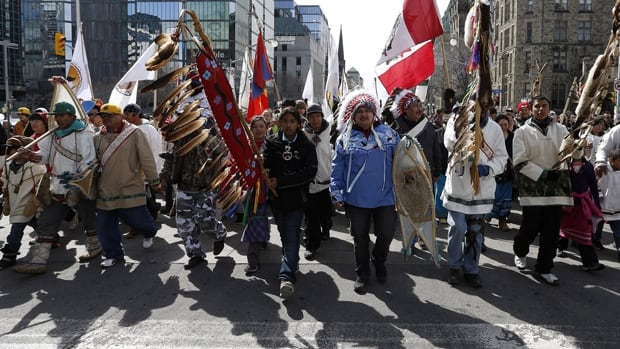 First Nations demonstrators march towards Parliament Hill in Ottawa March 25, 2013. in support of seven members of the Whapmagoostui First Nation in northern Quebec  who walked to Ottawa in support of the Idle No More movement. The movement plans over 63 protests and actions across Canada today.