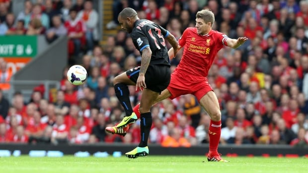 Liverpool's Steven Gerrard and Crystal Palace's Jason Puncheon, left, vie for the ball during their match at Anfield, Liverpool on Saturday.