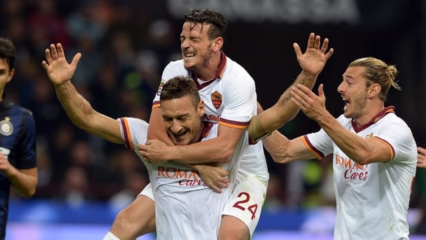 Francesco Totti of AS Roma celebrates his goal against Inter Milan at Stadio Giuseppe Meazza on October 5, 2013 in Milan, Italy.