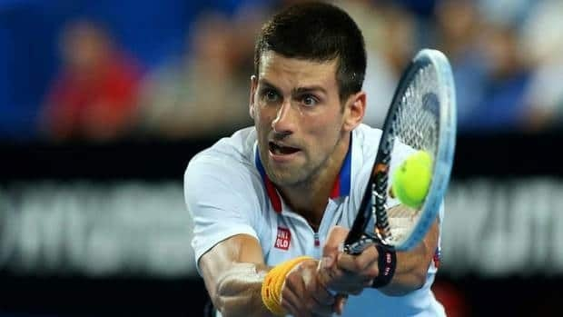 Novak Djokovic of Serbia plays a backhand in his singles match against Andreas Seppi of of Italy at the Hopman Cup at Perth Arena on Monday in Perth, Australia.
