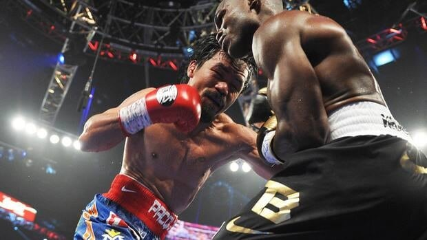 Manny Pacquiao, left, goes on the attack against Timothy Bradley during their WBO welterweight title match at the MGM Grand Arena in Las Vegas, Nevada on Saturday.