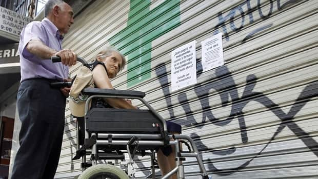 Placards announce a strike by pharmacies across Spain's Valencia region on Thursday in protest at the lack of  payments from the regional government.