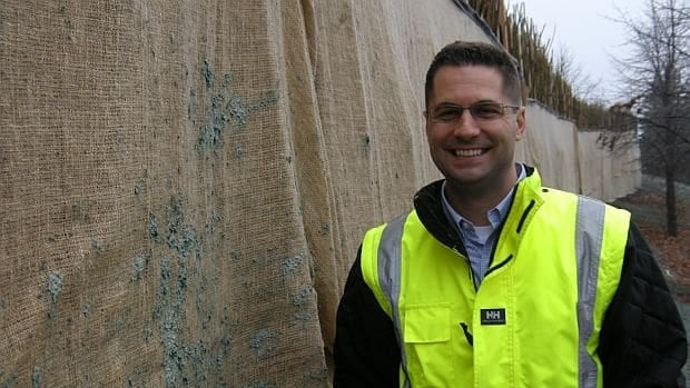 Chad Pearson, environmental superintendent with Xstrata Nickel's Falconbridge smelter, stands in front of the company's living wall, which will sprout and fill out in the spring.