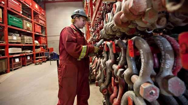 Kolby Nepoose, pre-apprentice crane operator works with shackles, rigging for cranes in the auxiliary equipment warehouse where she works in Edmonton. More women are beginning to enter the trades.