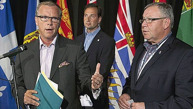 Saskatchewan Premier Brad Wall, Prince Edward Island Premier Robert Ghiz and Nova Scotia Premier Darrell Dexter, left to right, field questions at the annual Council of the Federation meeting in Halifax on Thursday.