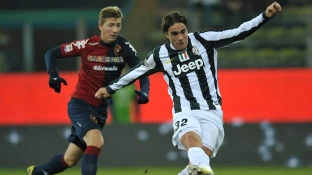 Juventus' Alessandro Matri, right, scores against Cagliari at Parma's Tardini stadium, Italy, on Friday.