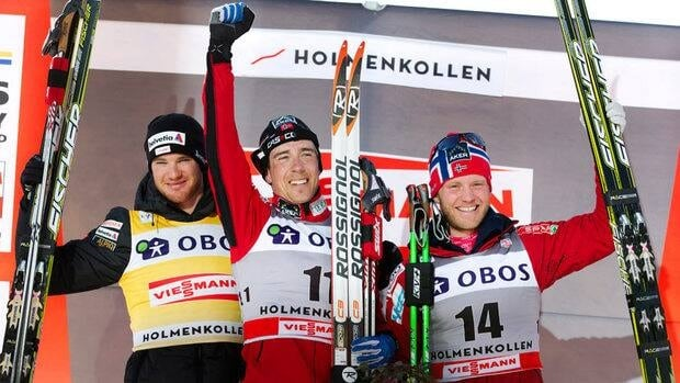 Eldar Roenning, centre, celebrates on the podium flanked by second placed Dario Cologna, left, Martin Johnsrud Sundby during the FIS Cross-Country World Cup.