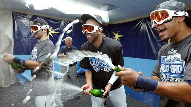 Find out how some of David Price's Tampa Bay Rays teammates, including Sean Rodriguez, left, and coach Joe Maddon, celebrated their ace's Cy Young Award on Twitter.