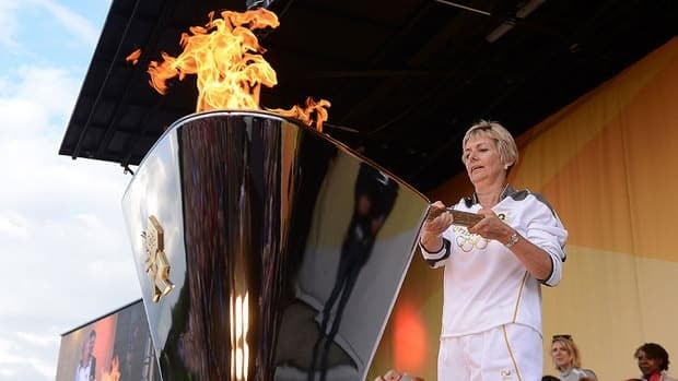 Torchbearer 136 Julia Chilcott lights the Cauldron with the Olympic Flame at the end of Day 62 of the Torch Relay leg.