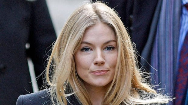 Rupert Murdoch's News International is reported to be challenging celebrity phone-hacking victim Sienna Miller over her legal bill.