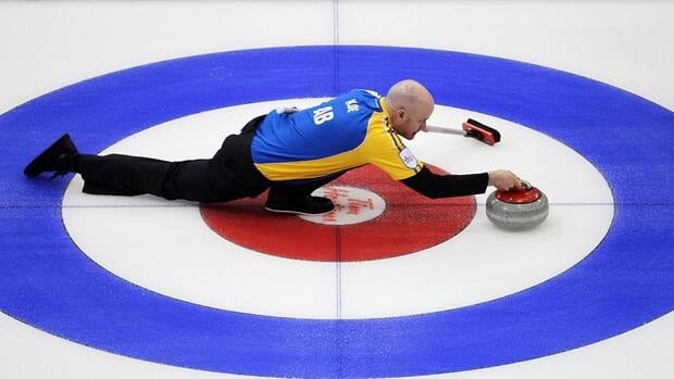 Alberta skip Kevin Koe makes a shot during an afternoon draw against PEI at the Brier in Saskatoon, Saskatchewan on Monday.