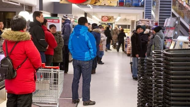 People in a supermarket observe two minutes of silence in  Nuuk, Greenland, at noon on Thursday. Greenland was in mourning Thursday after an eight-year-old girl and two women were bludgeoned to death and two men seriously injured in a remote Inuit village.