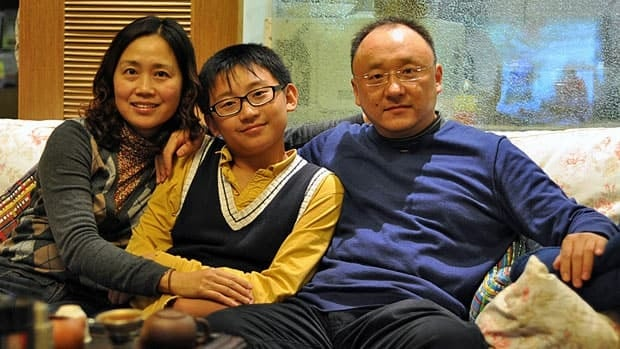 Jade and Jacob Zhou, seen here with son Jerry, have held off expanding their business in hopes of coming to Canada from China as immigrant investors.