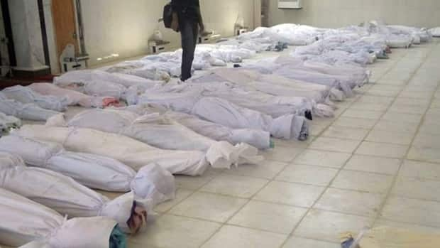 This citizen journalism image provided by Shaam News Network taken May 26, 2012, purports to show shrouded dead bodies following a Syrian government assault on Houla.