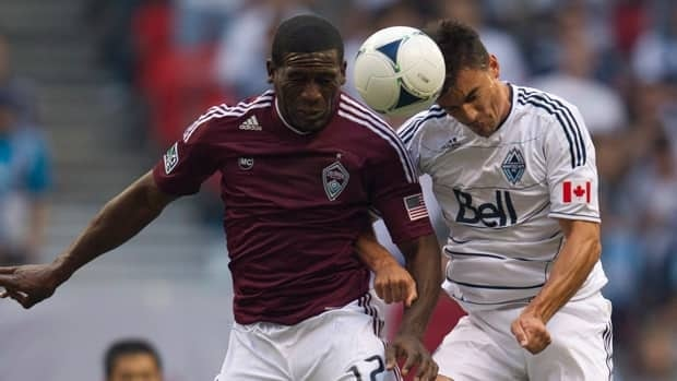 Alain Rochat of the Vancouver Whitecaps, right, fights for control of the ball with Colorado's Hendry Thomas during first half MLS action on Sunday.