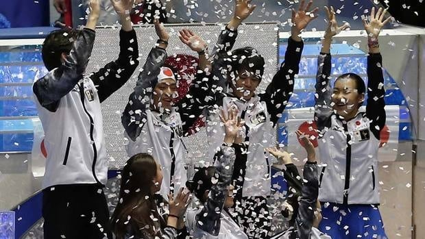 Members of the Japanese team celebrate their team trophy victory in Tokyo on Saturday afternoon. Canada was third in the six country competition.