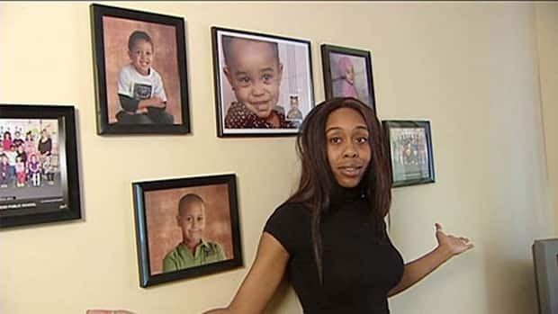 Natasha Mitchell says these are the only pictures she has of her children, after movers kept baby photos along with other belongings.