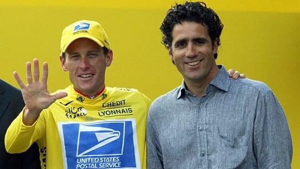 Lance Armstrong celebrates with five-time Tour winner Miguel Indurain at the end of the 20th and last stage of the 90th Tour de France in 2003. Armstrong won the Tour de France for the fifth time.