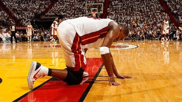 Miami's Chris Bosh is left behind the play Sunday against Indiana, felled by an injury.