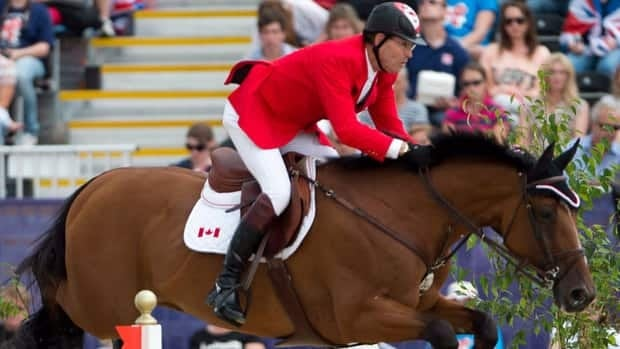 Canada's Ian Millar, from Perth, Ont., rides his horse Star Power over a jump in the Equestrian Individual Jumping final 2012 Summer Olympics last month.