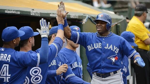 Rajai Davis, right, along with relief pitcher Darren Oliver will be back with the Toronto Blue Jays next season.