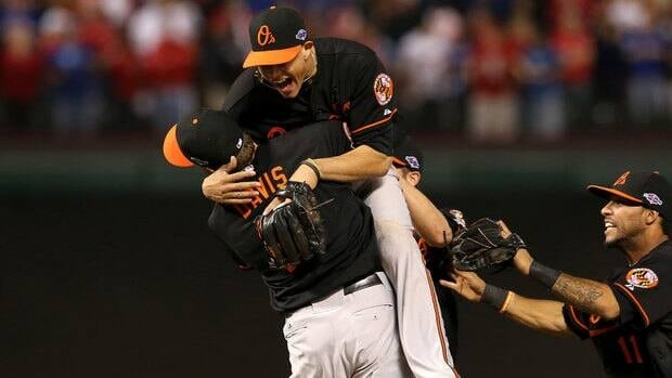 Manny Machado (13) and Chris Davis (19) of the Baltimore Orioles celebrate after they defeating the Texas Rangers 5-1 during the American League Wild Card playoff game  on Friday.