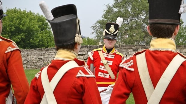 New recruits drill for tourists inside the walled compound of old Fort York in Toronto, June 12.