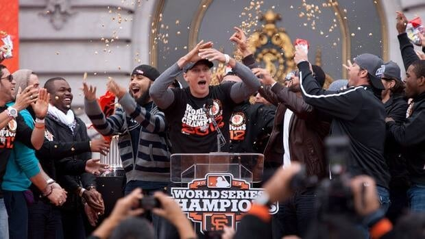 San Francisco Giants right fielder Hunter Pence leads his teammates during the team's World Series parade.