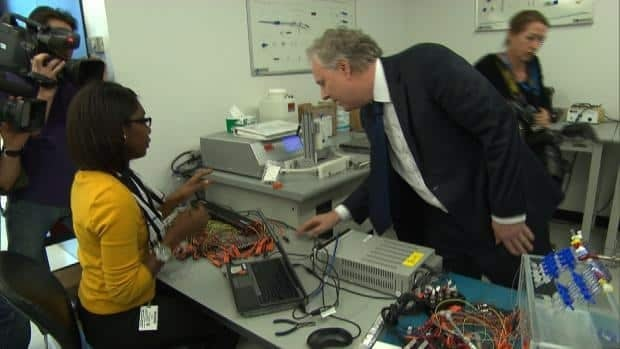 Quebec premier Jean Charest visits the Medtronic plant on Montreal's west island to announce a $15 million investment.