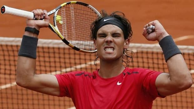 Rafael Nadal exults in Wednesday's 7-6, 6-2, 6-3 win over Nicolas Almagro at Roland Garros.
