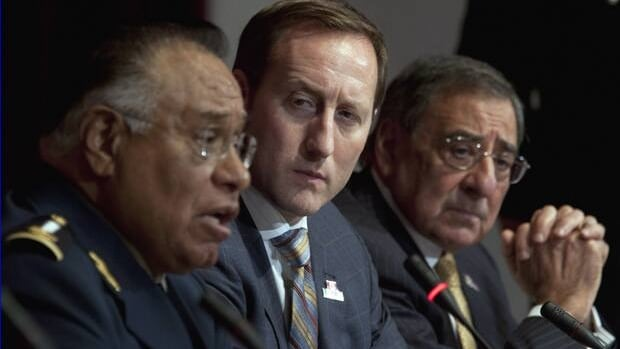 Defence Minister Peter MacKay (centre) and U.S. Secretary of Defence Leon Panetta listen to Mexican Secretary of National Defence Gen. Guillermo Galvan Galvain following meetings in Ottawa on Tuesday.