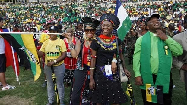 African National Congress delegates cheer during the ANC's 100th anniversary celebrations in Bloemfontein, South Africa, on Sunday.