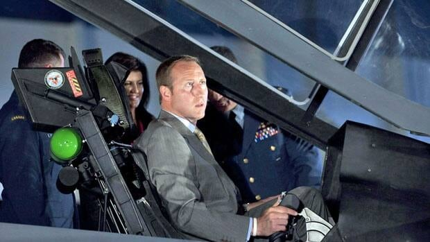 Canada's commitment to buying new F-35 fighter jets, such as the one in which Defence Minister Peter MacKay is seated in this file photo, is not certain, Julian Fantino says.