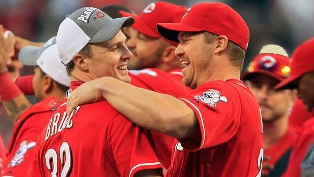 Cincinnati Reds' Jay Bruce, left, hugs teammate Scott Rolen after they defeated the Los Angeles Dodgers 6-0 to clinch the National League Central Division on Saturday.
