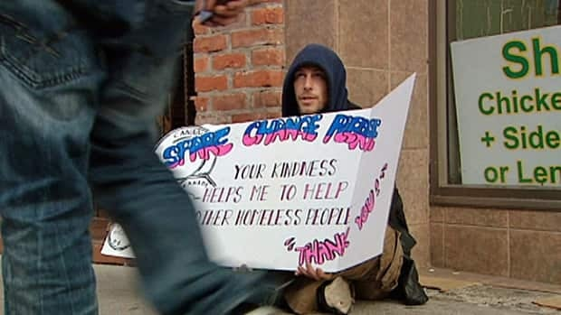 Robert is a panhandler who sits on Ouellette Avenue with a large cardboard sign and said he suffers from a disability and is also an alcoholic.