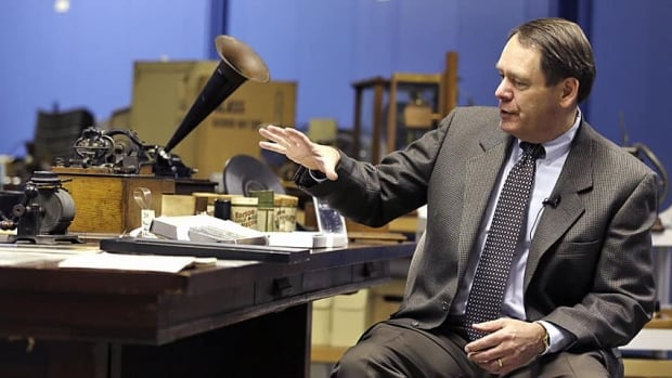 John Schneiter, a trustee at the Museum of Innovation and Science, talks about tinfoil phonographs Wednesday in Schenectady, N.Y. Researchers have digitized what experts say is the oldest recording of a playable American voice and history's first-ever recorded musical performance, along with the first recorded blooper.