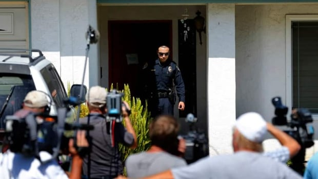 Reporters in San Diego, Calif., crowd in front of the home of the parents of shooting suspect James Holmes.